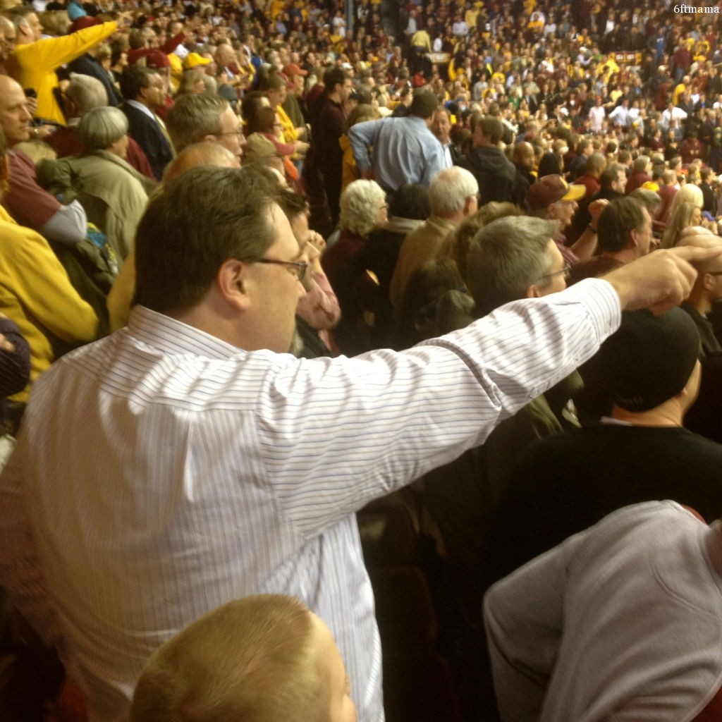 Phil pointing at scoreboard golden gophers