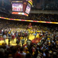 fans on court golden gophers