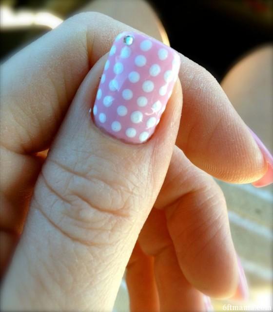 Thumb polka dot nail art