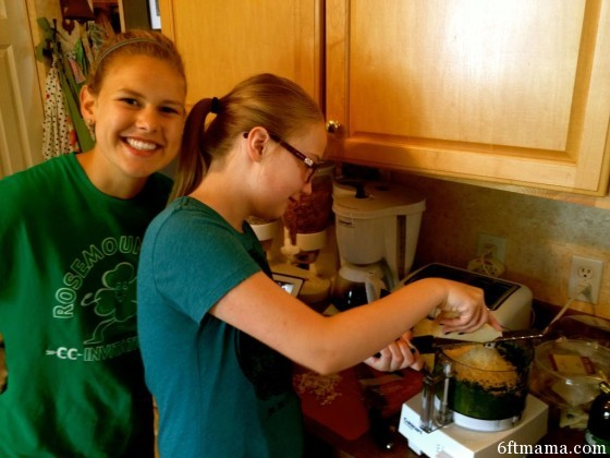 Emma grating Parmesan Reggiano
